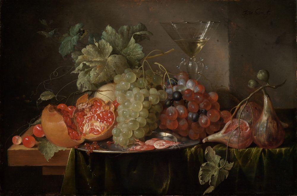 Fruchtstilleben mit gefülltem Weinglas