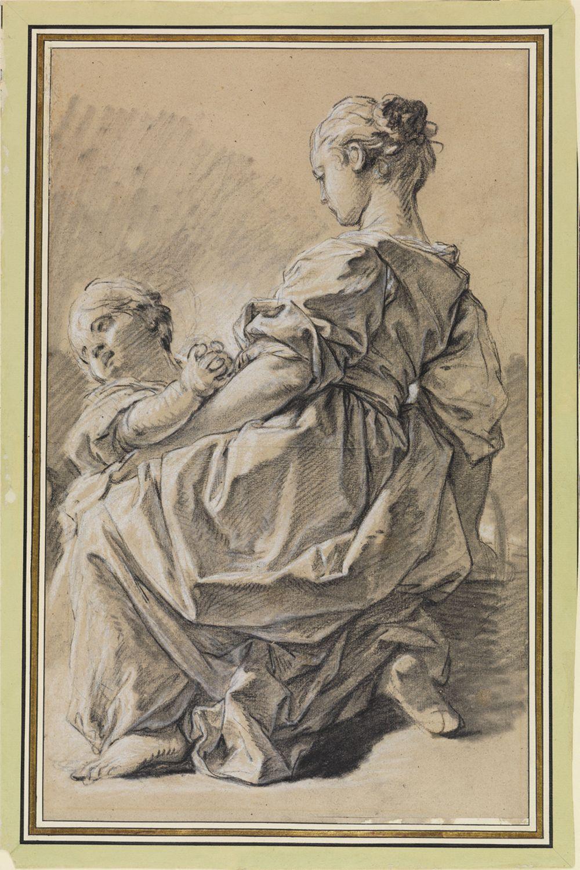 Kniende junge Frau mit Kind