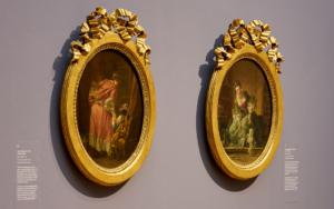 Goldrahmen im Detailausschnitt des Gemäldes Das verzogene Kind von François Boucher.